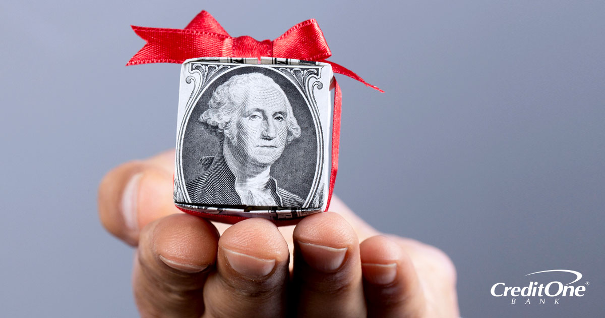One dollar bill wrapped in a red ribbon
