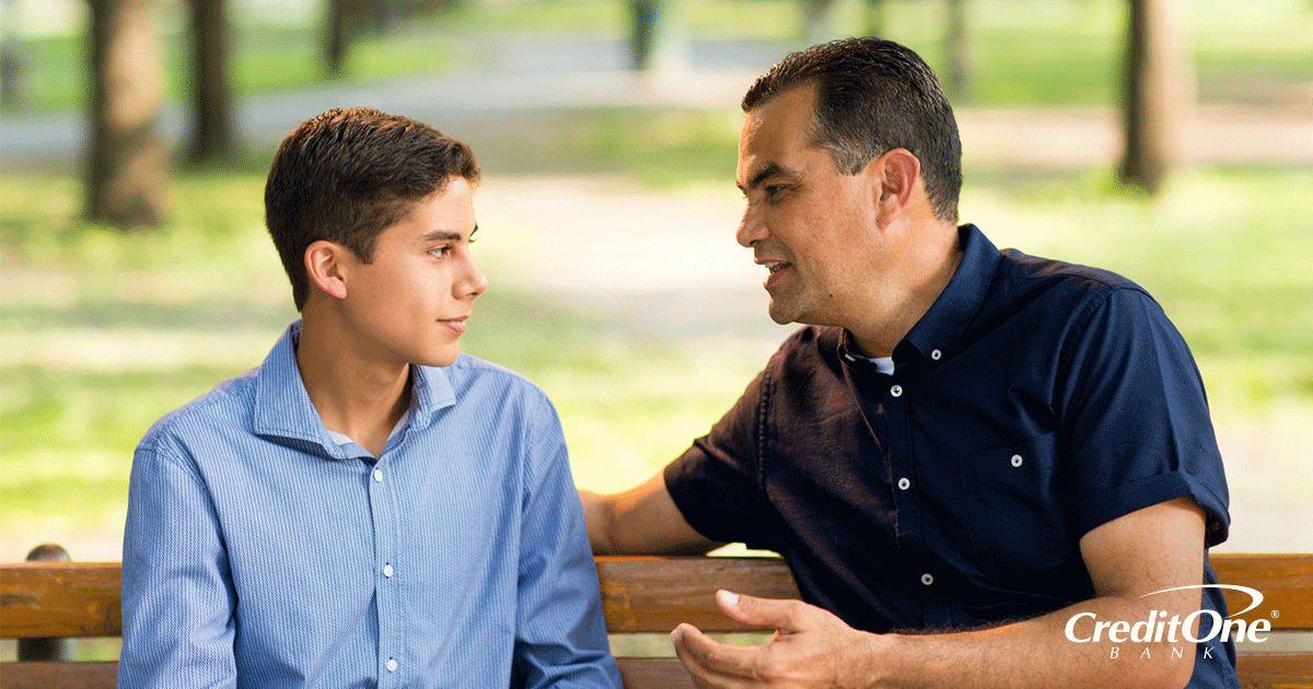 Father sharing financial advice with his son