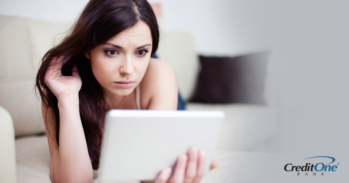 Woman reviewing her credit score and credit reports on tablet device