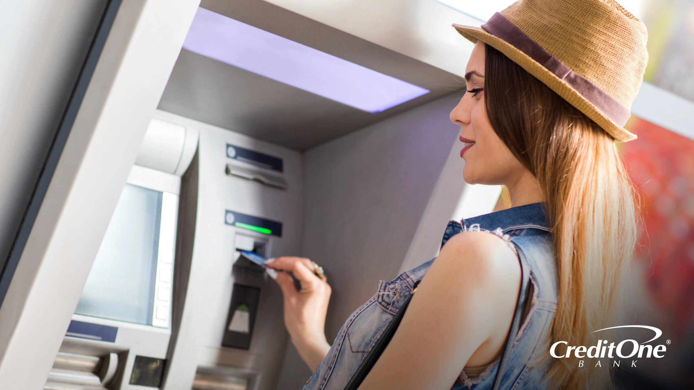 Woman withdrawing money from an ATM machine