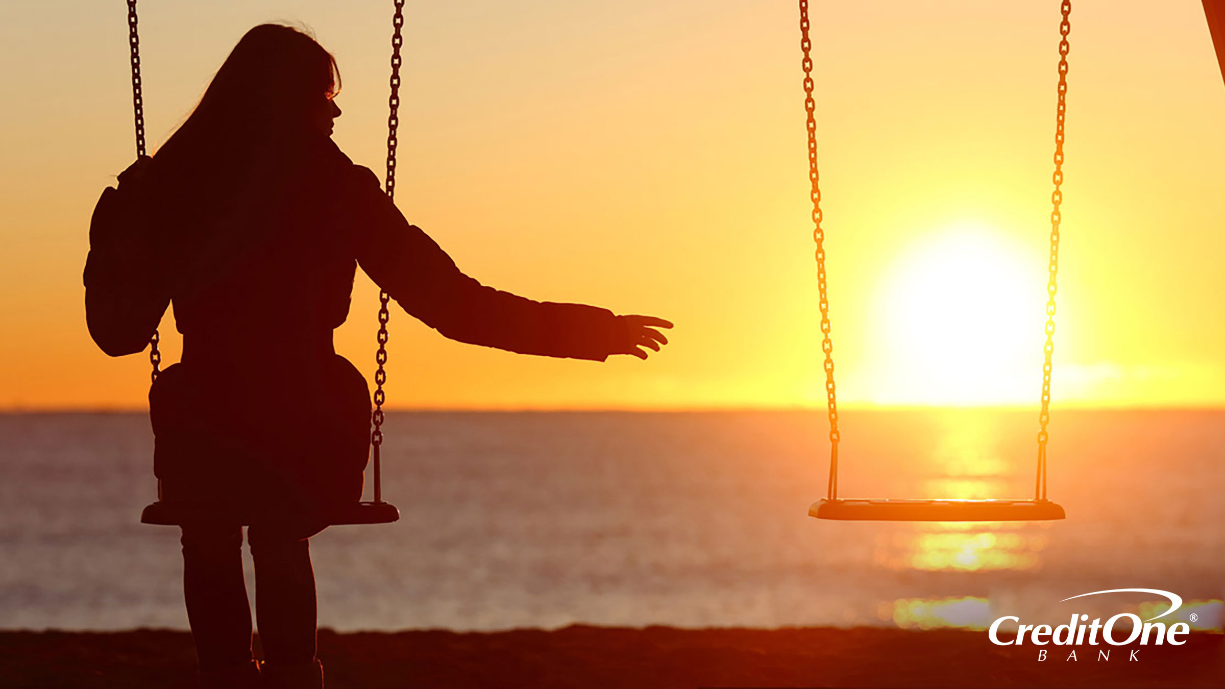 Woman on swings contemplating the loss of a loved one
