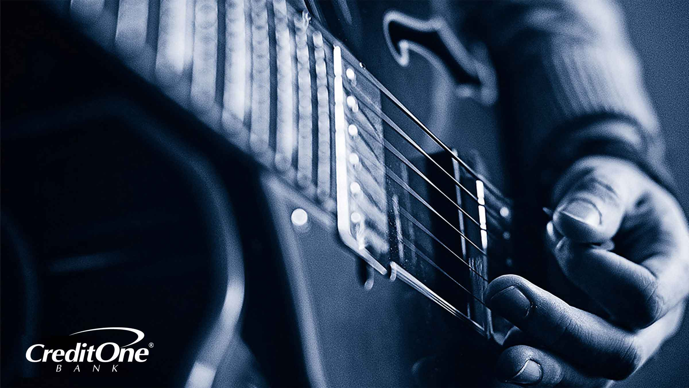 Closeup of a hand strumming a guitar