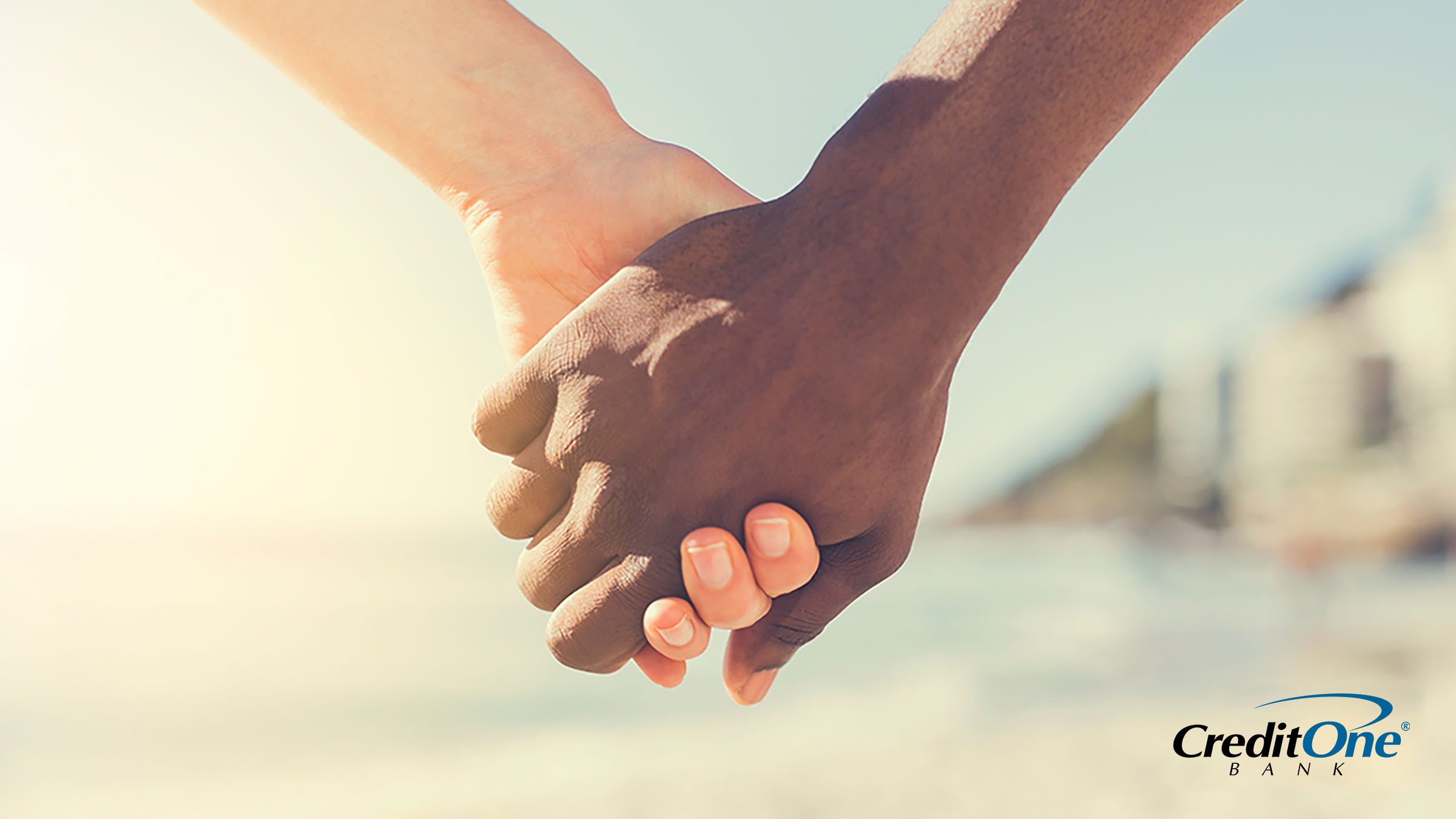 Two people holding hands demonstrating how income and credit come together