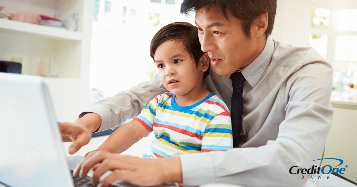 Father showing his infant son a budget on the computer